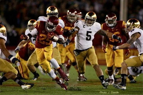 USC tailback Silas Redd escapes a tackle from Notre Dame's Manti Te'o.Photo: J. Gaede