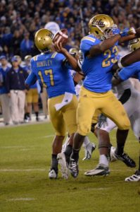 UCLA quarterback Brett Hundley faced pressure most of the game from a rugged Baylor defense. Photo Credit: Rondald Jenkins