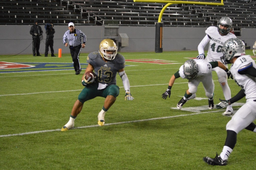 Long Beach Poly High School running back Manu Luuga rushes for some of his game-high 110 yards in the CIF California Division I championship football game against Granite Bay. Photo Credit: Ronald Jenkins