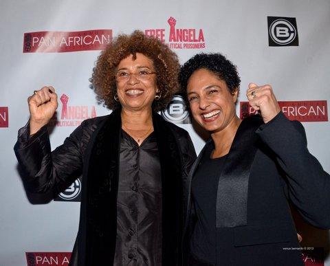 Angela Davis and director Shola Lynch have a little fun on the red carpet. Credit: Venus Bernardo