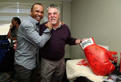 Boxing legend Sugar Ray Leonard and actor Bruce McGill have a light moment at the GBK Oscar Gifting Lounge at the Sofitel Hotel in Beverly Hills.