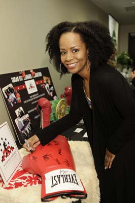 Actress Tempestt Bledsoe has some fun at the GBK Oscars Gifting Lounge. Photo courtesy of GBK Productions