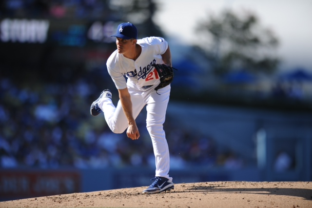 Pitcher Zach Greinke lead the Los Angeles Dodgers past against the Colorado Rockies on July 13, 2013 at Dodger Stadium in Los Angeles, California. Photo: Juan Ocampo