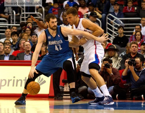 Blake Griffin, seen here against Minnesota big man Kevin Love, has picked up his play. Photo Credit: Jevone Moore/News4usonline.com