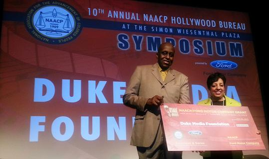 """Angela H. Polk Program Manager, Community Development for Ford Motor Company Fund       presented a $10,000 grant to Director Bill Duke, Founder of the Duke Media Foundation. Photo Credit: Photo credit: Louis """"Kengi"""" Carr"""