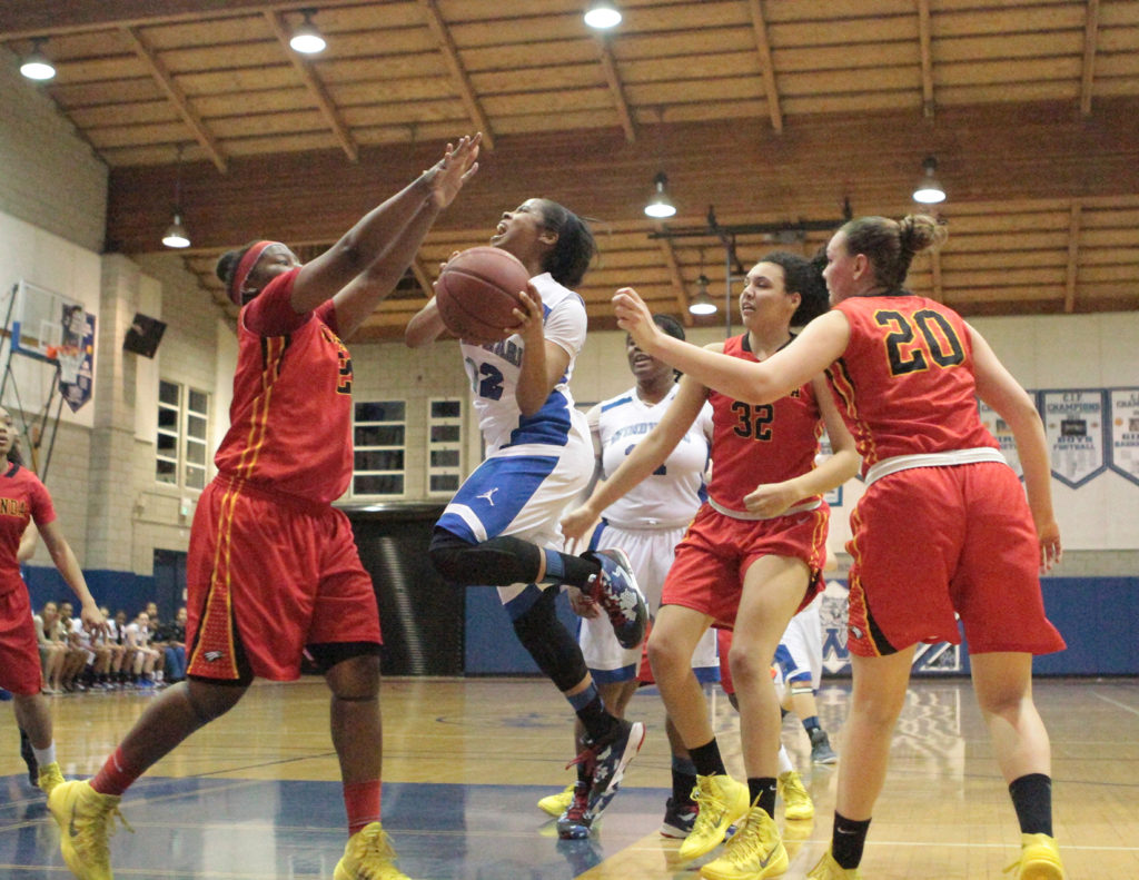 Etiwanda's Defense Surrounded Winward's Jordin Canada (12) who finished up with 23 points in 49-48 loss. Photo: Jevone Moore/News4usonline.com courtesy of Full Image 360