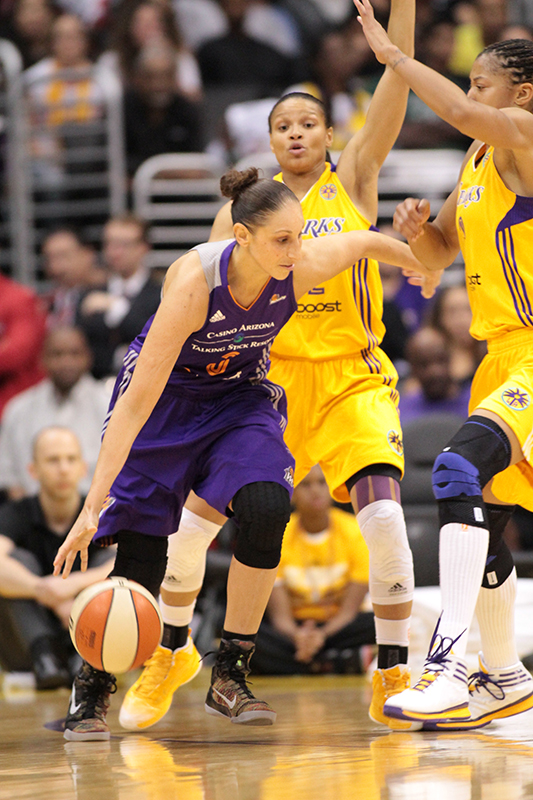 Mercury All-Star Diana Taurasi dribbling out of double team. Photo Credit : Jevone Moore / News4usonline.com