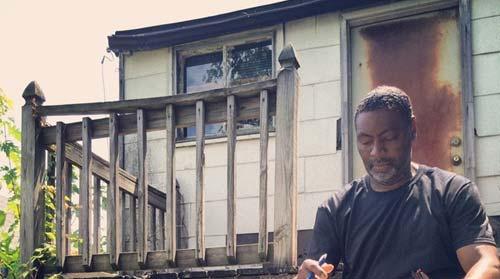 """local organizer in a town neighboring Ferguson, Mo., shows a typical """"porch."""" (Courtesy, Silicon Valley De-Bug.)"""