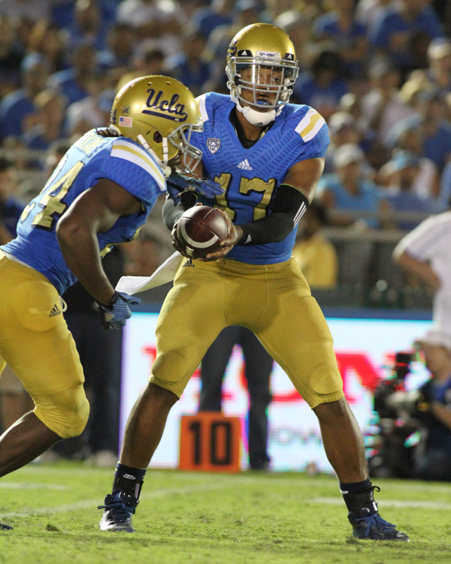 UCLA Quarterback Brett Hundley showing us read option play to running back Paul Perkins. Photo Credit : Jevone Moore Courtesy of Full Image 360 / News4usonline,com