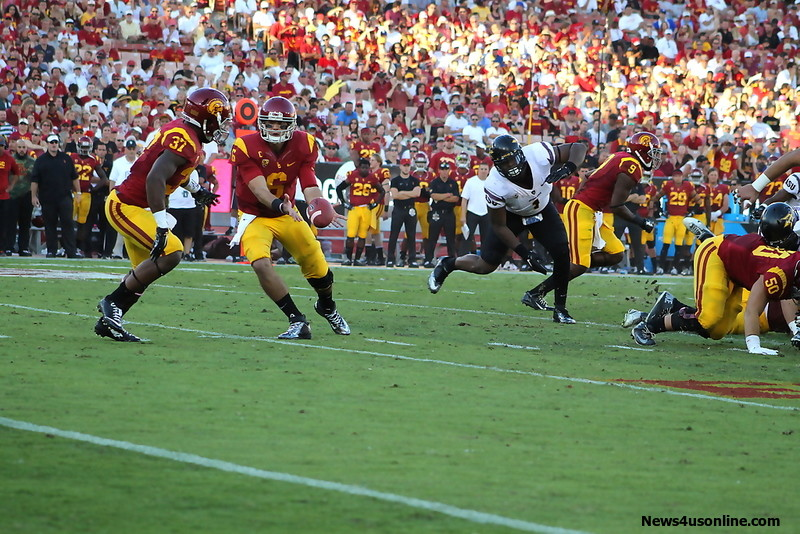 "USC quarterback Cody Kessler prepares to hand off to the running back ""Buck"" Allen against Arizona State on Saturday, Oct. 4, 2014. Photo Credit: Dennis J. Freeman/News4usonline.com"