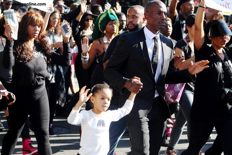 Tyrese and daughter show the Hands up! Don't Shoot sign during the Blackout Hollywood march on Saturday, Dec. 6. Photo Credit: Dennis J. Freeman/News4usonline.com