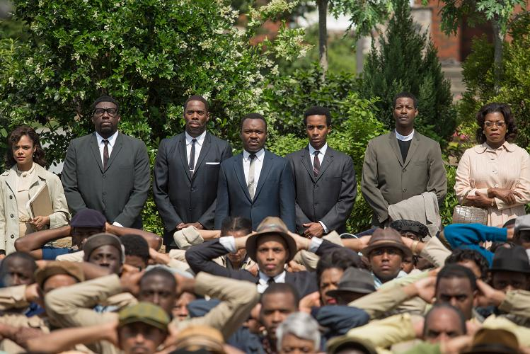 Background left to right: Tessa Thompson plays Diane Nash, Omar Dorsey plays James Orange, Colman Domingo plays Ralph Abernathy, David Oyelowo plays Dr. Martin Luther King, Jr., André Holland plays Andrew Young, Corey Reynolds plays Rev. C.T. Vivian, and Lorraine Toussaint plays Amelia Boynton in SELMA, from Paramount Pictures, Pathé, and Harpo Films.