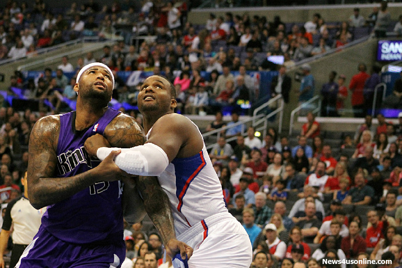 """One of those nights: Sacramento center DeMarcus Cousins and Glen """" Big Baby"""" Davis battle in the paint for a rebound during a 2013-2014 regular season game played  at Staples Center. Davis and the Clippers defeated the Kings 126-99 Saturday, Feb. 21, 2015. Photo by Dennis J. Freeman/News4usonline.com"""