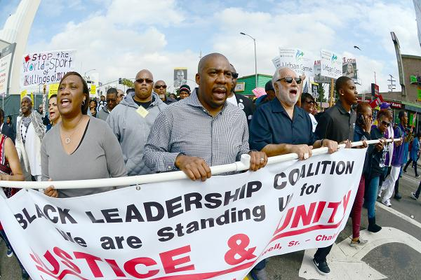 March For Justice -  March and Rally held in the Crenshaw Distrcit of Los Angeles, California, USA.  February 21, 2015.  March started at LAPD Headquarters on Martin Luther King, Jr. Blvd and proceeded to Leimert Park. In attendance were Danny Blakewell,  Rev. Exavier Thompson, Congress Woman Karen Bass, and members of the Ezell Ford family.  Ford was shot to death by LAPD officiers in August of 1984.  This march was a protest of police violence and brutality and coincided with similar marches across the country as well as the 50th Anniversay of the slaying of Malcom X. Photo by SCOTT Mitchell
