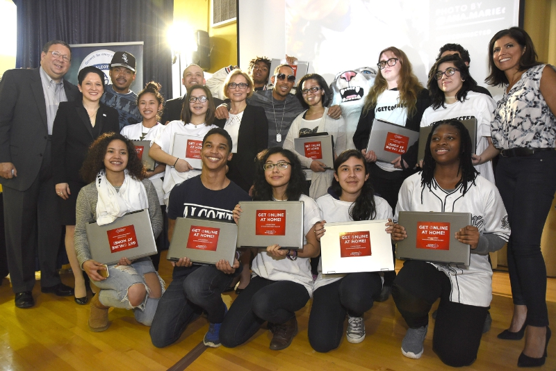 Chance The Rapper and Ludacris helped close the digital divide Tuesday by presenting new Internet Essentials laptops to Alcott College Prep students in Chicago. The surprise visit kicked off the Get Schooled, Get Connected Spring Challenge. (PRNewsFoto/Internet Essentials)