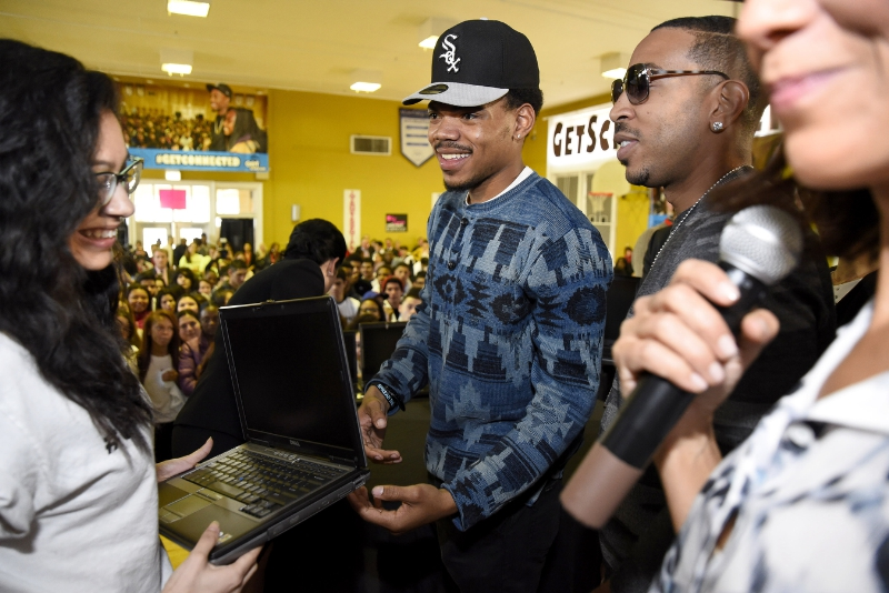 Chance the Rapper (left) and Ludacris present a new Internet Essentials laptop to an Alcott College Prep student on Tuesday in Chicago apart of the Get Schooled, Get Connected Spring Challenge. (PRNewsFoto/Internet Essentials)