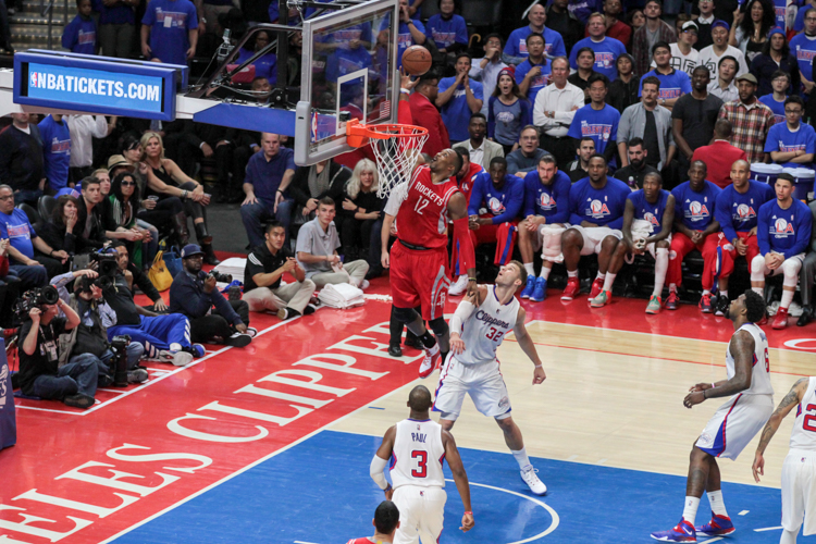 Houston's Dwight Howard soaring high with 20 points in the game. Photo by Jevone Moore/News4usonline.com