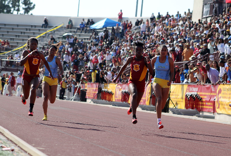 USC sprinter Alexis Faulknor speeds down the track in the 100 meters in a dual meet against UCLA. Faulnor recorded a swift 11.3 winning time. Photo by Dennis J. Freeman/News4usonline.com