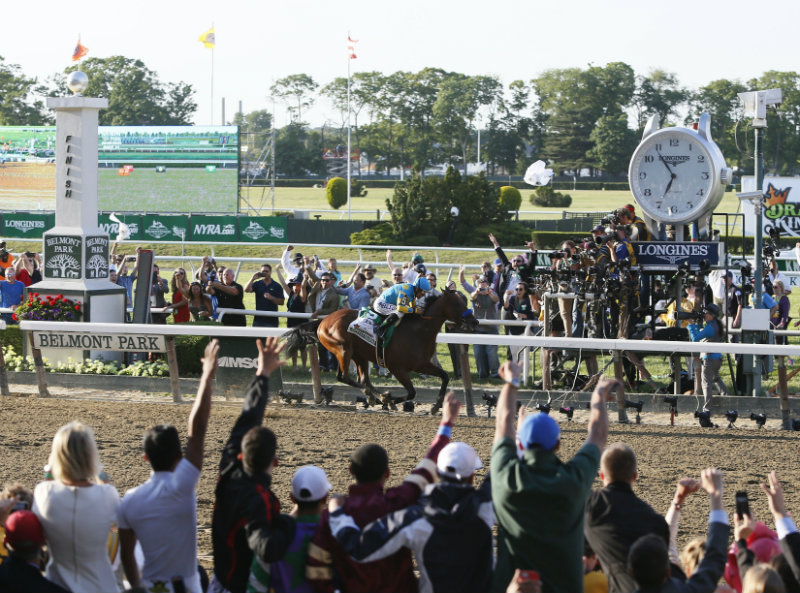 Victor Espinoza rides American Pharaoh to a stunning victory by five and half lengths at the 147th Belmont Stakes at Belmont Park Race Track, to secure the first Triple Crown win in 37 years, Saturday, June 6, 2015 in Elmont, N.Y. (Photo by Stuart Ramson/Invision for Longines/AP Images)