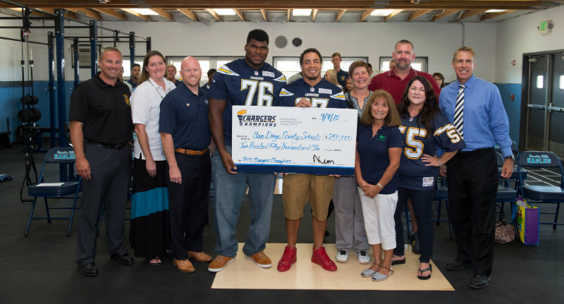 San Diego school representatives, along with San Diego Chargers offensive lineman D.J. Fluker