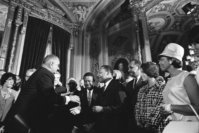President Lyndon B. Johnson meets with Martin Luther King, Jr. at the signing of the Voting Rights Act of 1965. Photo courtesy of Wikipedia Commons through Lyndon Baines Johnson Library and Museum