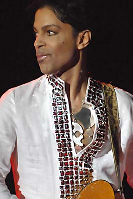 Prince performing at Coachella 2008. Photo courtesy of Wikipedia Commons/Michamedia