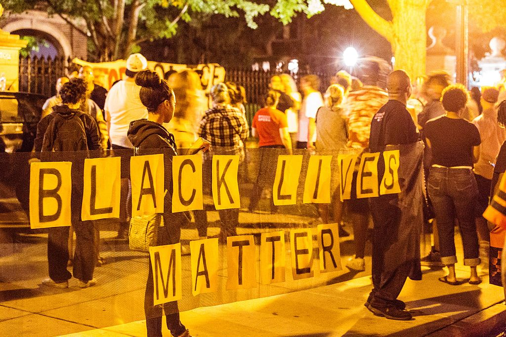 A crowd of community members gather outside the Governor's Residence in Saint Paul, Minnesota, in the 2 a.m. hour on July 7, 2016, following the police shooting of Philando Castile in Falcon Heights, Minnesota, by a St. Anthony Police officer. Photo Credit: Tony Webster/Wikipedia Commons