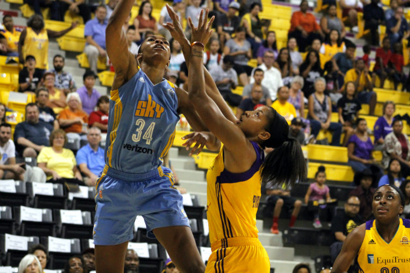 Los Angeles Sparks forward Candace Parker defends against the Chicago Sky during her team's 95-75 playoff semifinals win at the Walter Pyramid in Long Beach, California. Photo by Dennis J. Freeman/News4usonline