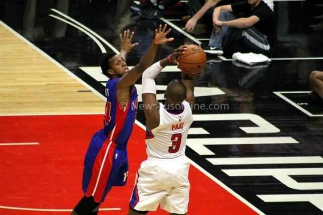 Chris Paul gets this shot off against a Detroit Pistons defender during the Los Angeles Clippers' 114-82 win at Staples Center on Monday, Nov. 7, 2016. Photo by Dennis J. Freeman/News4usonline.com