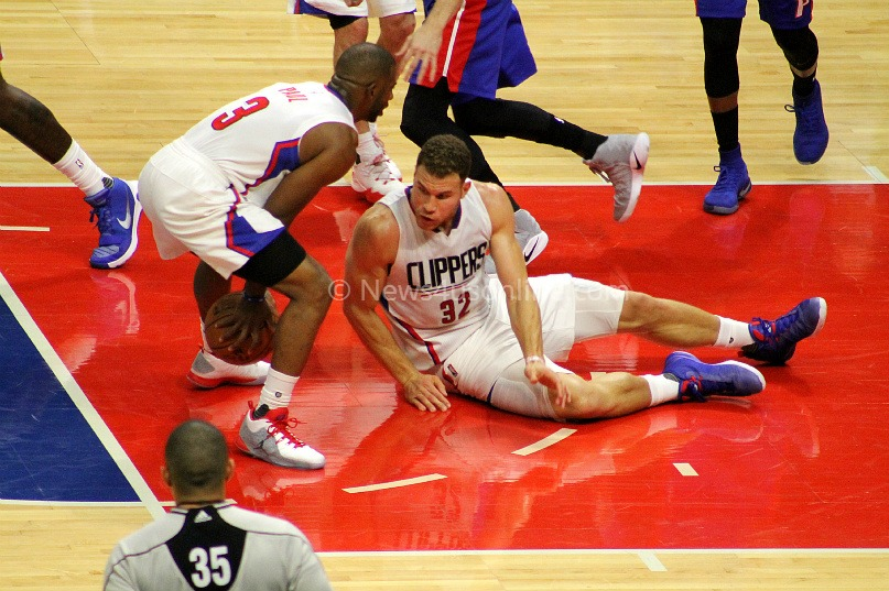 Chris Paul and Blake Griffin scramble for a loose ball against the Detroit Pistons. Photo by Dennis J. Freeman/News4usonline.com