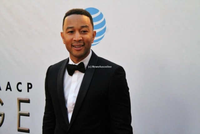 Musician John Legend steps on the red carpet at the 48th Annual NAACP Image Awards on Saturday, Feb. 11, 2017. Photo by Dennis J. Freeman/News4usonline