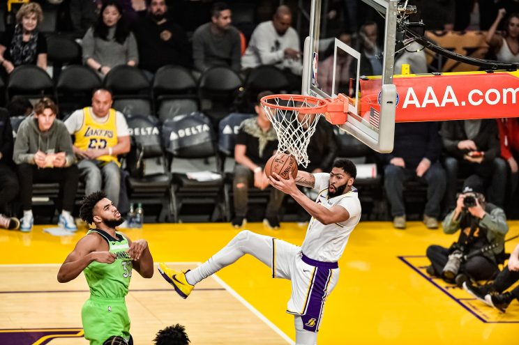 Anthony Davis grabs a rebound for the Lakers