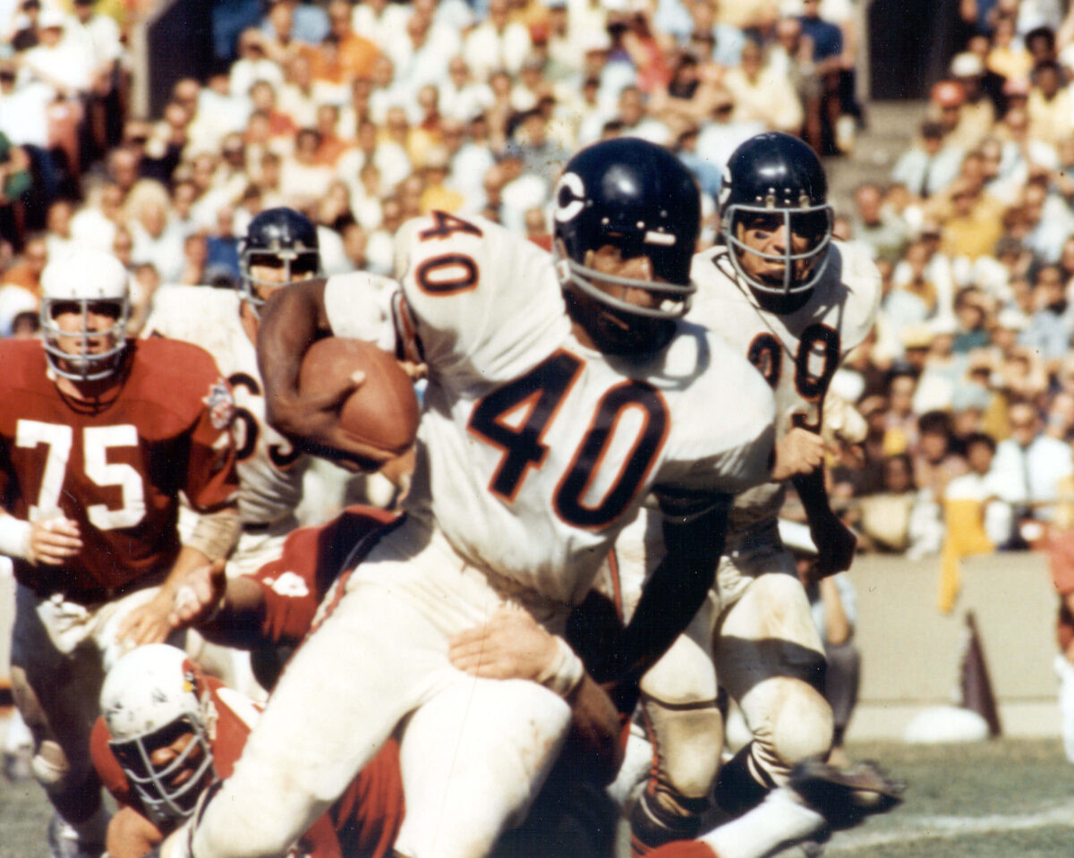Gale Sayers running the football