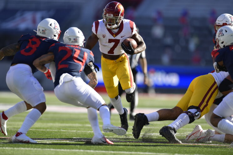 USC running back Stephen Carr (7) runs through a crease in the Arizona Wildcats defense on Saturday, Nov. 14, 2020. Photo by USC Athletics