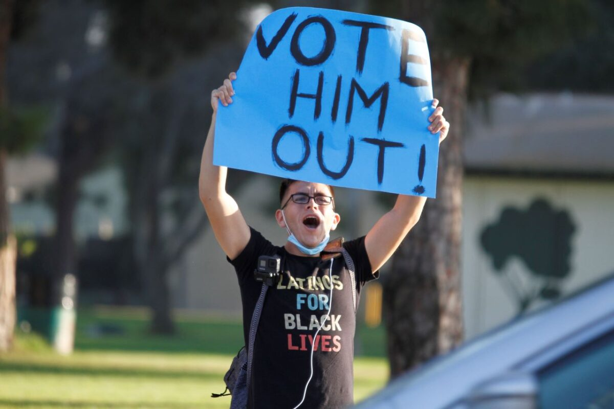 A demonstrator sounds off about getting No. 45 out of office via the voting route on Election Day