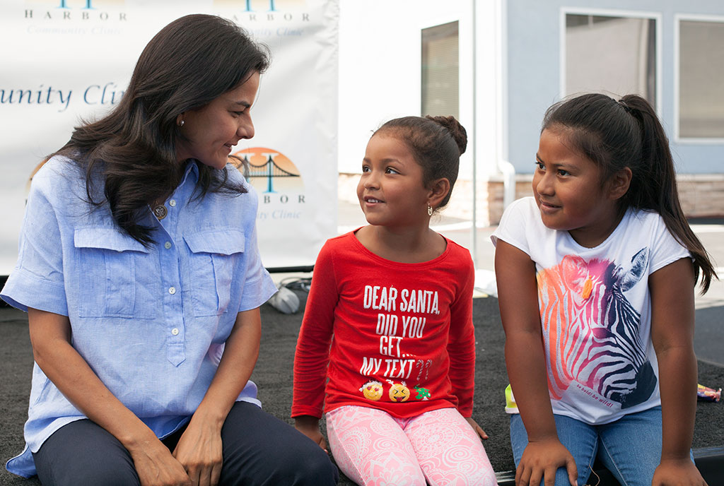 U.S. Congresswoman Nanette Diaz Barragan hanging out with young constituents of the 44th District that she represents. Photo appears courtesy of Congresswoman Nanette Diaz Barragan.