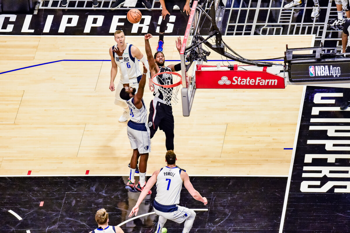 Los Angeles Clippers guard Paul George (13) gets off a shot against the defense of Tim Hardaway Jr. in Game 5. George scored 23 points in the Clippers' 105-100 defeat at STAPLES Center. Photo credit: Mark Hammond for News4usonline