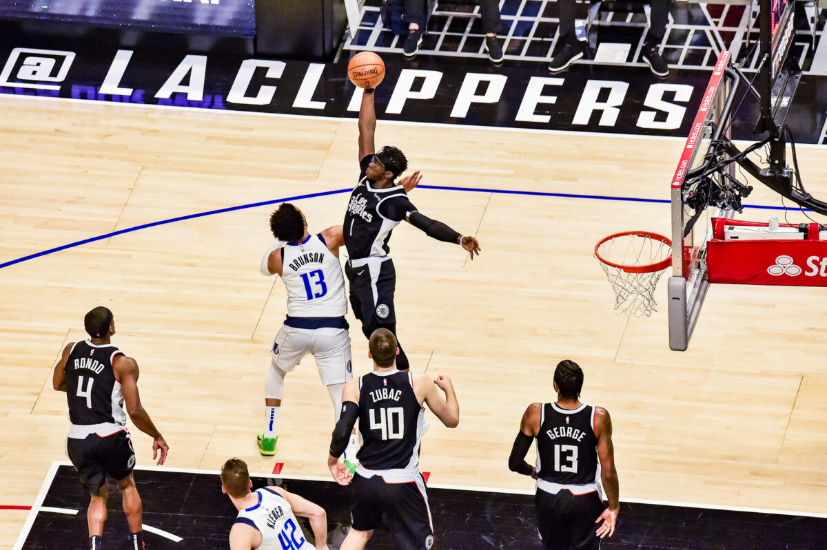 June 6, 2021-Los Angeles Clippers guard Reggie Jackson (1) goes up high for the rebound in Game 7. The Clippers defeated the Mavericks, 126-111. Photo credit: Mark Hammond/News4usonline