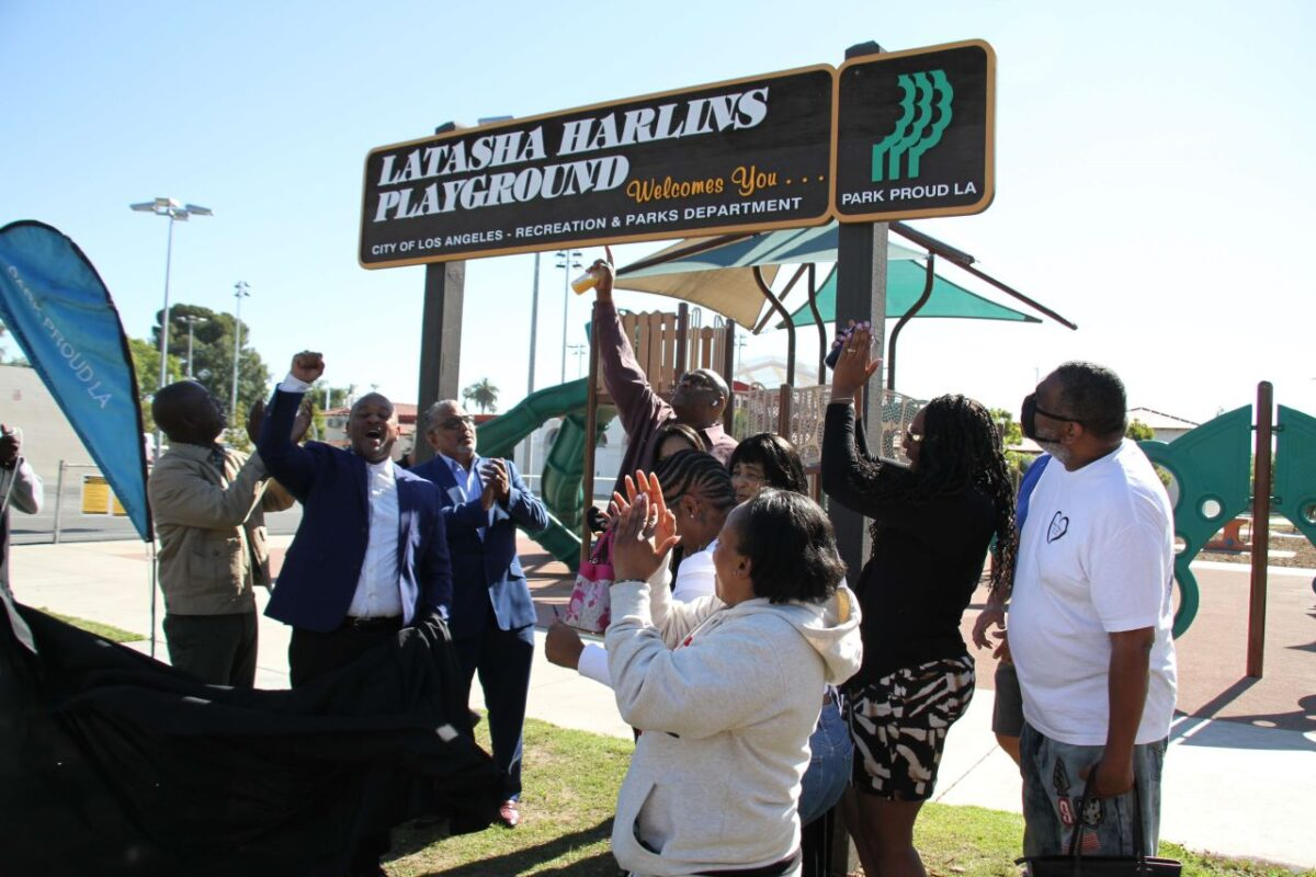 A celebration: The family of Latasha Harlins as well as city officials and well-wishers celebrate the unveiling of the Latasha Harlins Playground at Algin Sutton Recreation Center in South Los Angeles. Photo credit: Dennis J. Freeman/News4usonline